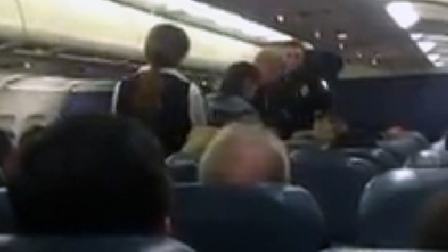 Passenger Fine escored off plane