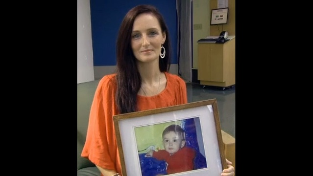 Rachel Pennewell holds photo of Tyler