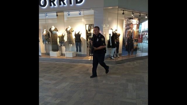 Officer runs through mall