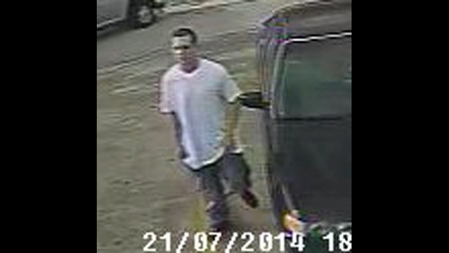 Surveillance photo of man at BP