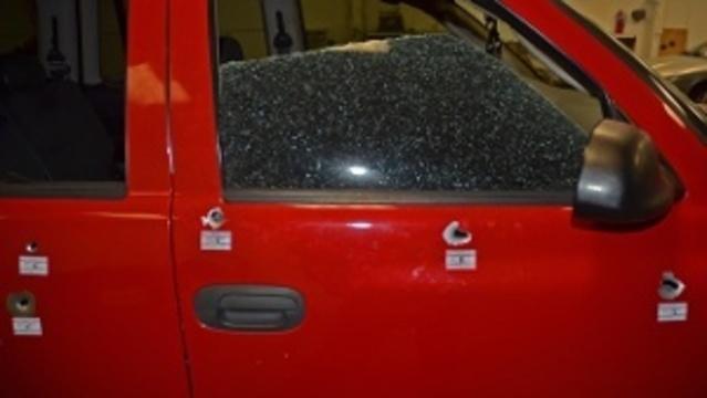 Bullet holes in SUV