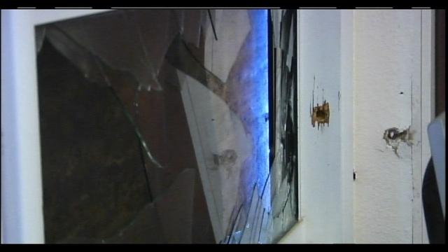 SWAT shooting house window
