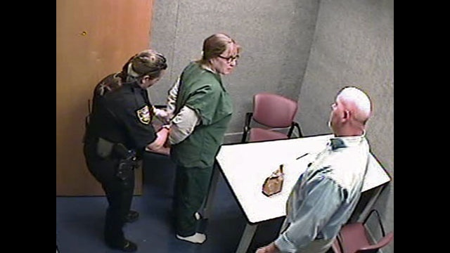 Gill-in-handcuffs-after-int-jpg.jpg_19941972