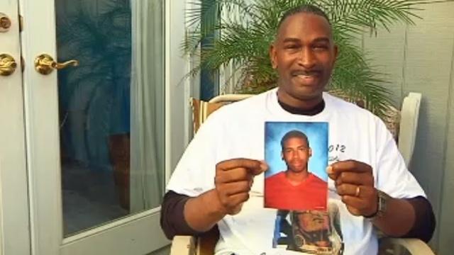 Ron Davis holding Jordan's photo