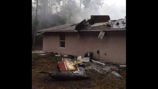 Wing of plane that crashed into Palm Coast home