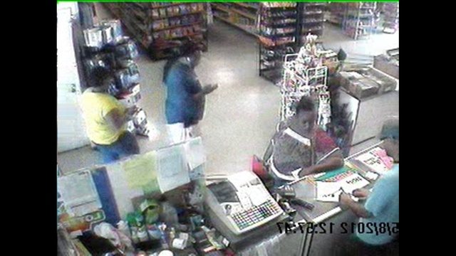 Black Female Suspect Larceny and Forgery Photo 3