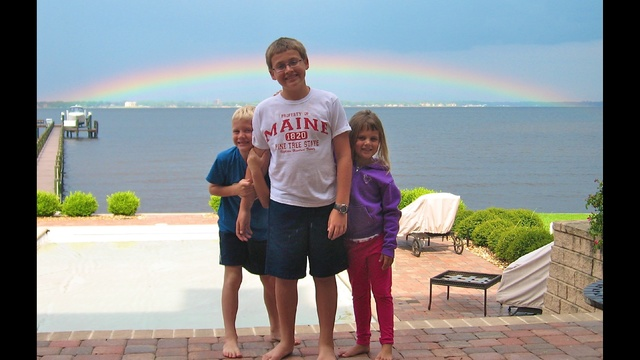 Ryan-with-siblings-in-front-of-rainbow-JPG.jpg_17271270