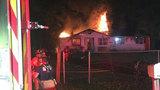 Crews battle house fire in Northwest Jacksonville