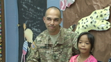 Army soldier surprises 6-year-old daughter at school