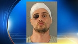 Police: Mother beat robber with baseball bat