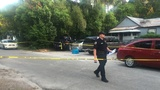 Man holding baby dies in triple shooting in Gainesville