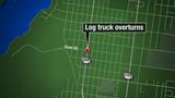 Log truck overturns in Fernandina Beach