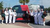 Khan, Jaguars Foundation donate van to military outreach organization