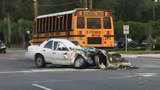 Driver in critical condition crash with school bus
