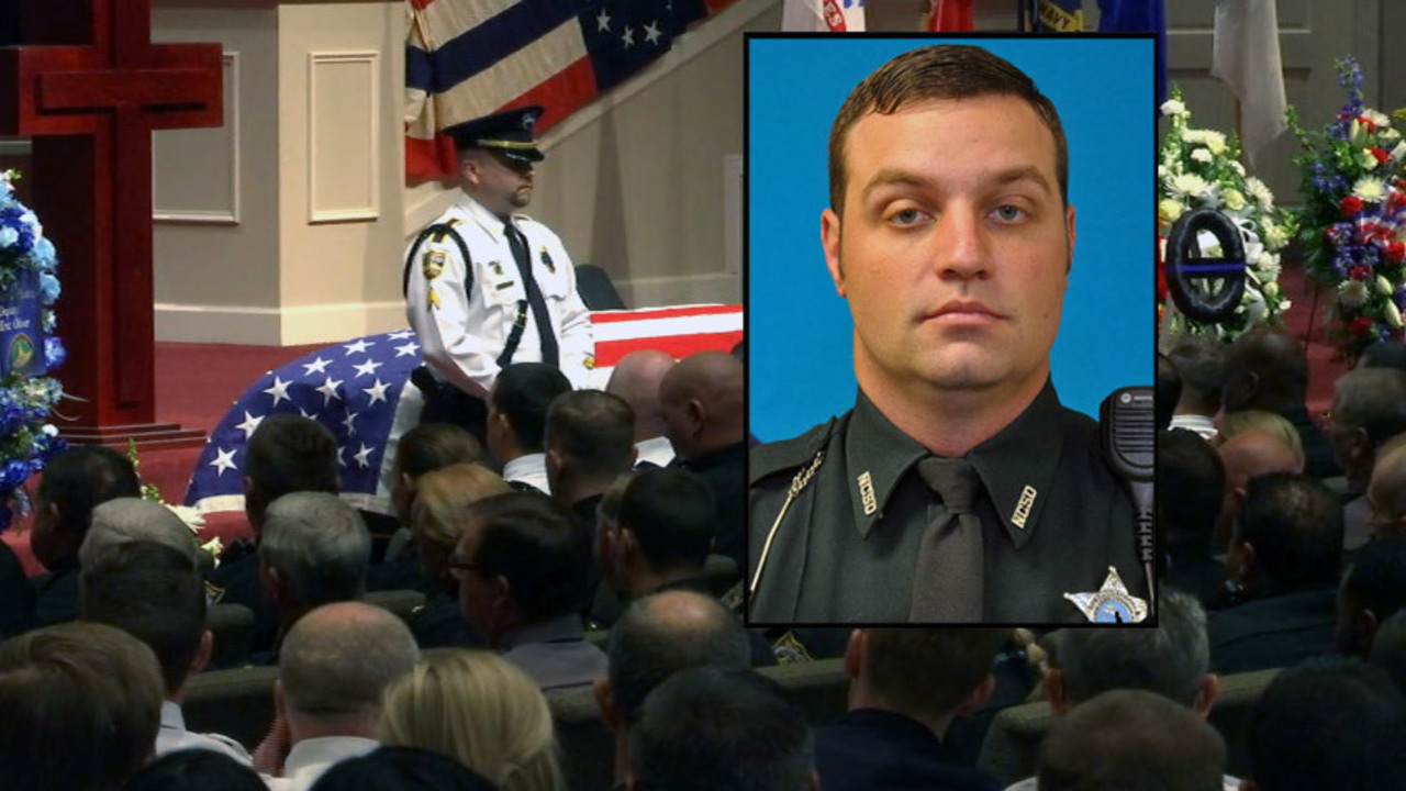 Hundreds say farewell to fallen deputy