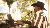 Musician helps ease holiday travel tensions at JAX