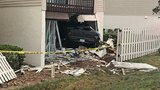 Woman escapes injury when truck slams into apartment