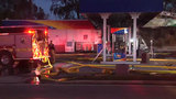 Arlington gas station catches fire