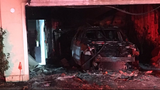 Fire damages home, destroys car parked in garage