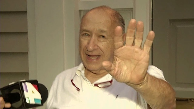 Dr. Howard Schneider avoiding Channel 4's camera