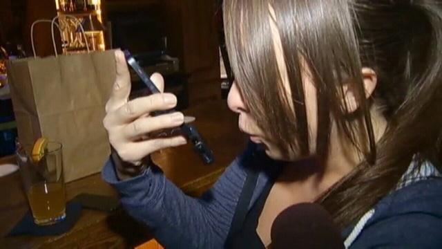 Breathometer-girl-blows-into-device.jpg_25698972