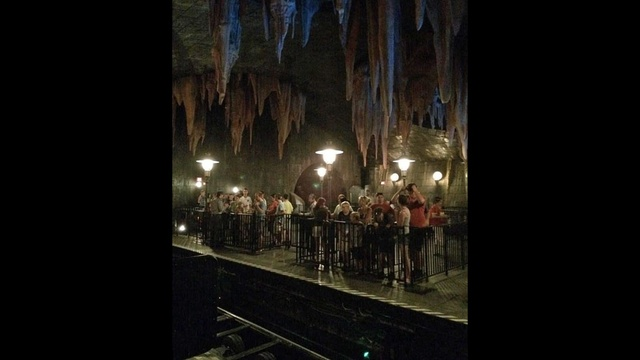 People wait to ride Escape from Gringotts