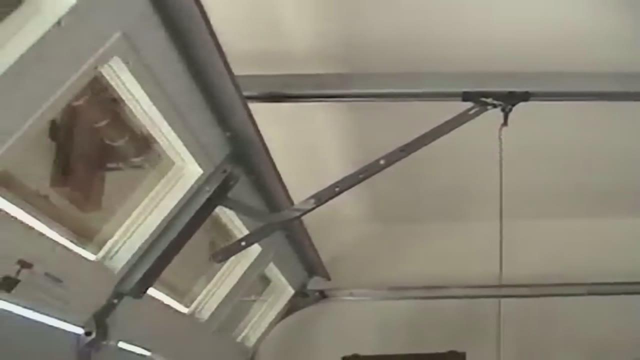 Thief can open your garage door in 6 seconds for Roll out screen door