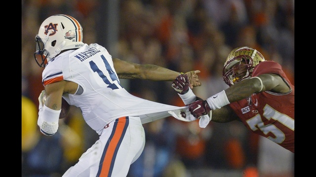 Auburn's Marshall runs through tackle_23804906