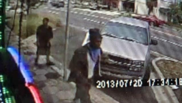 Surveillance camera shows James Rhodes outside Metro PCS store