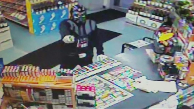 Image result for man robs store in darth vader outfit
