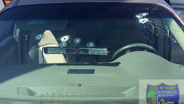 Bullet holes in detectives's windshield