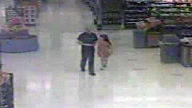 Donald Smith and Cherish walk in Walmart