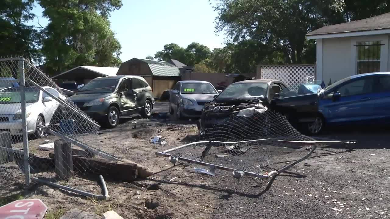 Driver Plows Through Gate Into Car Lot