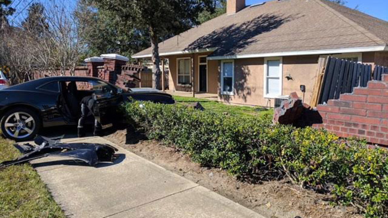 Car Crashes Into A Brick Wall