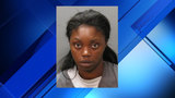 Police: Woman fails to get medical care for child burned by iron