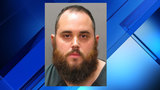 Man threatened woman, baby with gun, police say