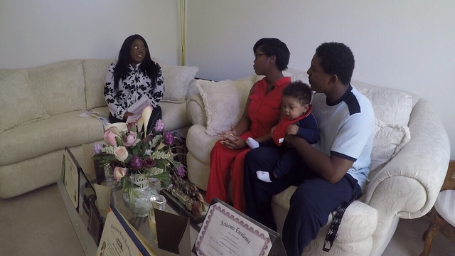 Fadale Mathis' family with social service worker