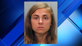 Mom charged with neglect after 2 kids left in hot car, police say