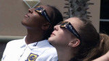 Students catch varying views of solar eclipse