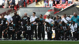 About two dozen players kneel for national anthem in London