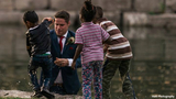 Viral photo shows groom rescuing child during wedding photo shoot