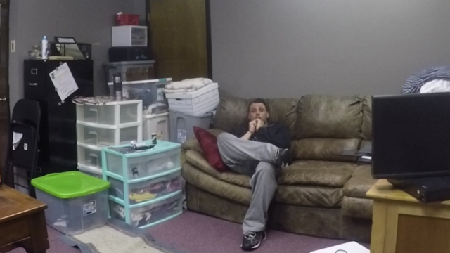 Nader Rayan sitting in bond office