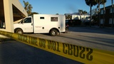 Police: Armed robber makes off with $48K from Loomis armored truck