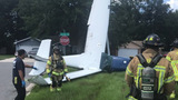 Single-engine plane crashes in front yard, pilot unharmed