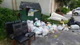 Dumpsters overflowing at St. Nicholas apartment, condo complex
