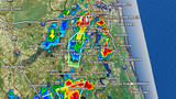 Scattered storms pushing northeast across Duval, St Johns, & Nassau