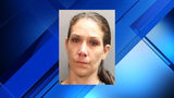Police: Child undergoes surgery for skull fractures, woman arrested