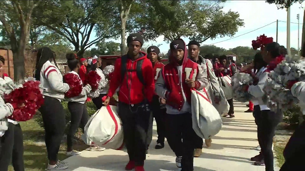 raines gives football team spirited send off to championship game