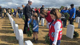 Thousands lay wreaths on graves at Jacksonville National Cemetery
