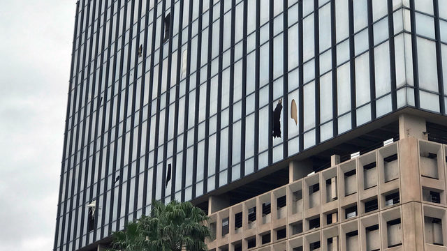 City Hall implosion leaves nearby windows shattered, piles of debris
